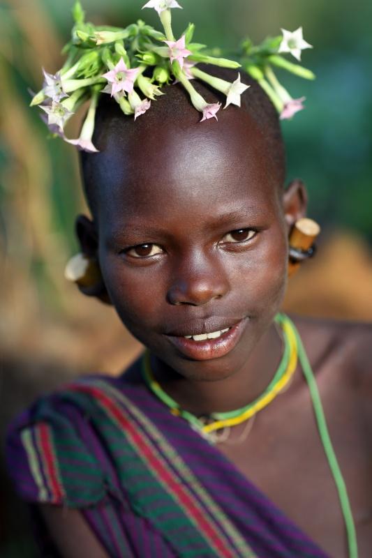 Ethiopian Tribes, smiling Suri girl - Dietmar Temps