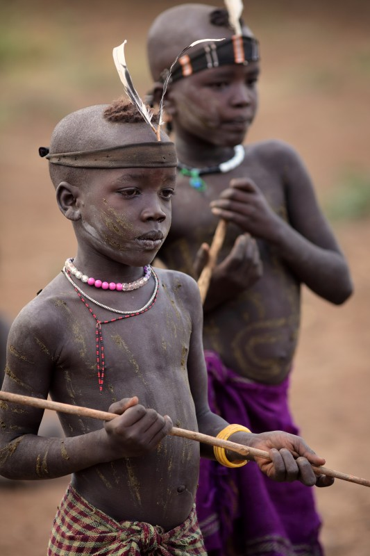 Young Mursi boys with stick, Ethiopia